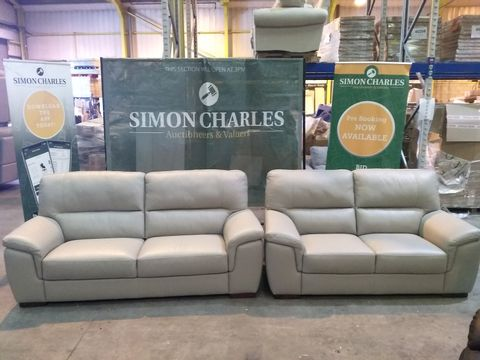 Lot 1993 QUALITY ITALIAN CREAM LEATHER UPHOLSTERED THREE AND TWO SEATER SOFAS
