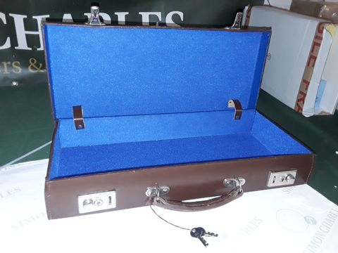 Lot 8256 BROWN LEATHER CASE WITH LOCKS AND KEYS