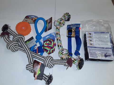 Lot 3134 LOT OF 8 ASSORTED PET ITEMS TO INCLUDE ANXIETY JACKET, LEAD & COLLAR AND VARIOUS DOG TOYS