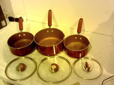 Lot 15385 COOKS ESSENTIALS COVERED SAUCEPAN SET
