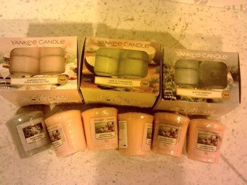 Lot 201 YANKEE CANDLE 53 PIECE TEALIGHT & VOTIVE COLLECTION WITH VOTIVE HOLDERS