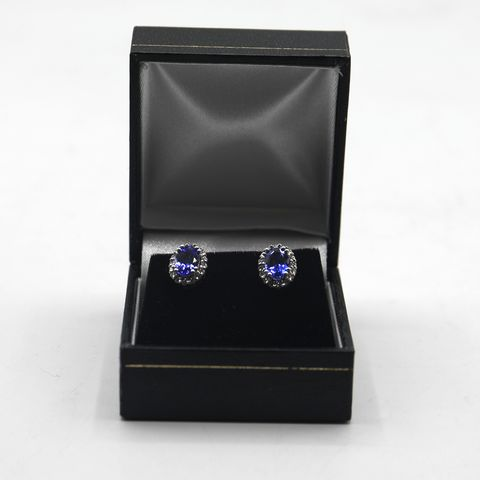 Lot 18 DESIGNER 18ct WHITE GOLD STUD EARRINGS SET WITH OVAL TANZANITE TO DIAMOND HALO WEIGHT +-1.83ct