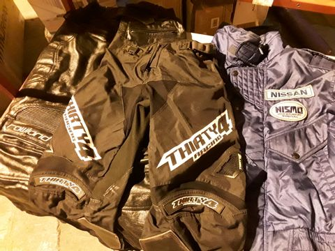 Lot 72 THREE ITEMS OF USED CLOTHING, NISMO QUILTED NISSAN JACKET ( NO SIZE) PAIR THIRTY 4 RACING BLACK MOTOCROSS TROUSERS(SIZE 26-27) & PAIR ROWLAND BLACK LEATHER MOTORCYCLE TROUSERS (SIZE UK 30)