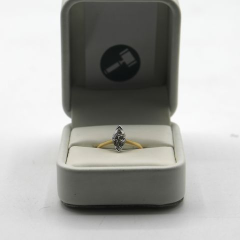Lot 13 DESIGNER 18ct GOLD SOLITAIRE RING SET WITH A MARQUISE CUT DIAMOND WEIGHING +-1.04ct