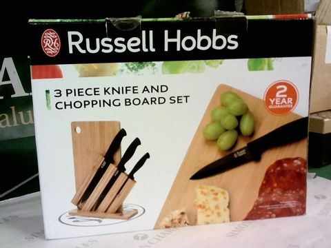 Lot 8562 RUSSELL HOBBS 3 PIECE KNIFE AND CHOPPING BOARD SET