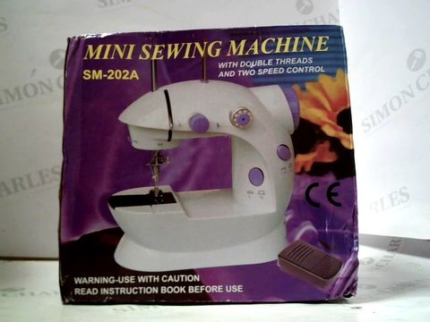 Lot 8461 MINI SEWING MACHINE SM-202A