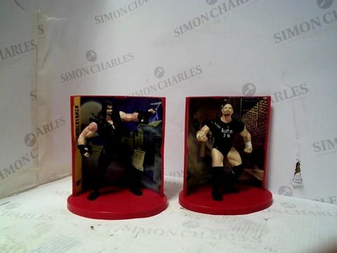 Lot 100 WF FIGURES THE UNDERTAKER + STONE COLD STEVE AUSTIN