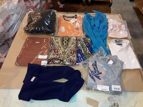 Lot 4057 CAGE OF ASSORTED UNPROCESSED ADULT CLOTHING PRODUCTS