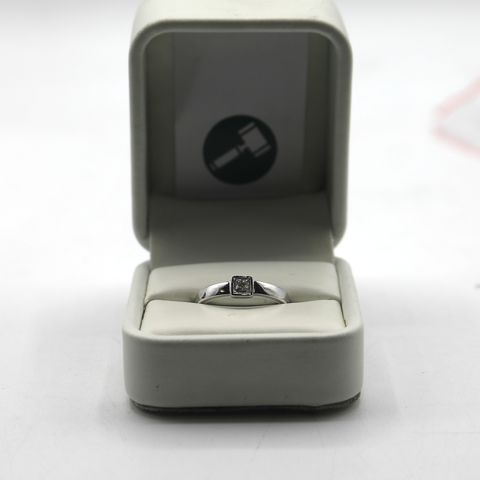 Lot 9 DESIGNER 18ct WHITE GOLD RING RUB-OVER SET WITH A PRINCESS CUT DIAMOND