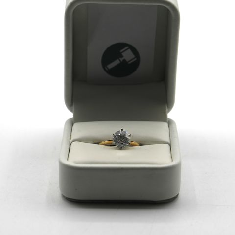 Lot 12 DESIGNER 18ct GOLD SOLITAIRE RING SET WITH A DIAMOND WEIGHING +-1.56ct