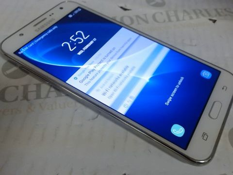 Lot 7606 SAMSUNG GALAXY J7 MOBILE PHONE WHITE