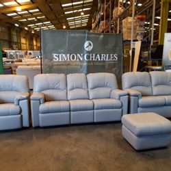 Lot 1000 QUALITY BRITISH MADE HARDWOOD FRAMED GREY LEATHER FOUR PIECE SUITE CONSISTING OF A POWER RECLINING THREE SEATER SOFA, FIXED TWO SEATER SOFA, POWER RECLINING ARMCHAIR AND FOOTSTOOL