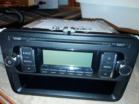 Lot 18 VW CAR RADIO/CD PLAYER WITH CODE