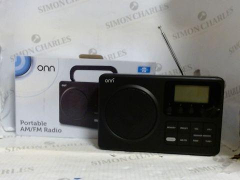 Lot 789 ONN PORTABLE AM/FM RADIO