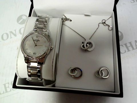 Lot 410 ROTARY MOTHER OF PEARL AND SWAROVSKI DATE DIAL STAINLESS STEEL BRACELET LADIES WATCH WITH NECKLACE AND EARRINGS GIFT SET RRP £259.00