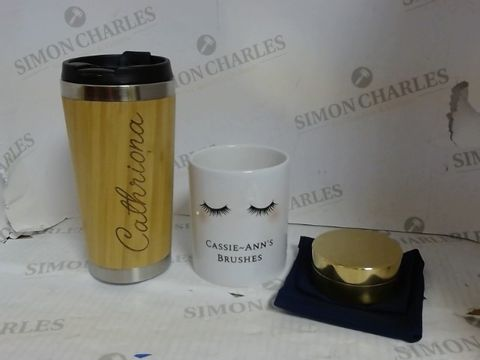 Lot 4613 A LOT OF APPROXIMATELY 9 PERSONALISED HOUSEHOLD ITEMS TO INCLUDE: GOLD ICONIC ADVENTURES SUNDIAL COMPAS, EYELASHES CERAMIC POT, BAMBOO TRAVEL MUG, ETC. RRP £221.95