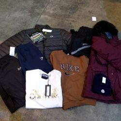 Lot 27 CAGE OF ASSORTED CLOTHING ITEMS TO INCLUDE: REGATTA COAT, CANADA GOOSE COAT, CALVIN KLEIN GOLF JAVKET, NIKE JUMPER, ZARA TOP, MONCLER HAT, NEXT JEANS, LYKE AND SCOTT JUMPER, SCRUFFS WORK TROUSERS ETC