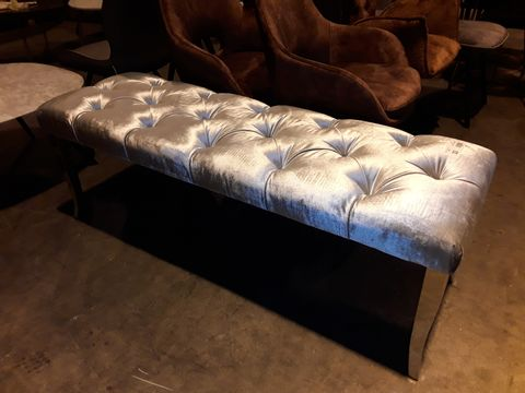 Lot 33 DESIGNER LARGE RECTANGULAR SILVER BUTTONED FABRIC BENCH ON POLISHED METAL LEGS
