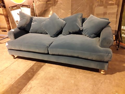 Lot 528 DESIGNER TURQUOISE VELVET THREE SEATER SOFA WITH SCATTER CUSHIONS