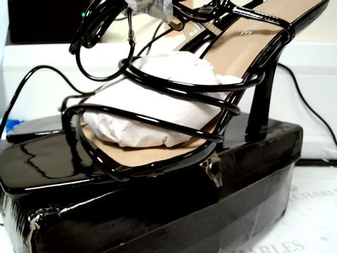 Lot 4752 PAIR OF BOXED DESIGNER IN THE STYLE BLACK PATENT LACED LEG STILLETO SANDALS SIZE 7/40