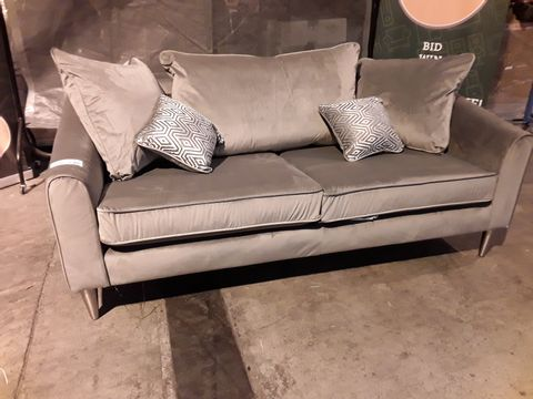 Lot 519 DESIGNER SILVER FABRIC THREE SEATER SOFA WITH SCATTER CUSHIONS