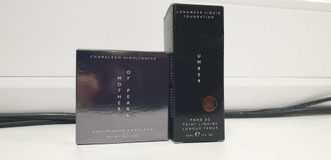 Lot 8028 BOX OF APPROXIMATELY 75 BRAND NEW TOP SHOP MAKEUP ITEMS TO INCLUDE UMBER LONGWEAR LIQUID FOUNDATION AND MOTHER OF PEARL CHAMELEON HIGHLIGHTER