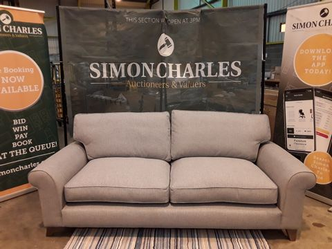 Lot 2018 QUALITY DESIGNER BRITISH MADE GREY FABRIC FOUR SEATER SOFA ON WOODEN FEET