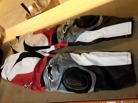 Lot 49 PAIR OF ALKSTAR RED/BLACK/RED LEATHER MOTORCYCLE TROUSERS SIZE 32