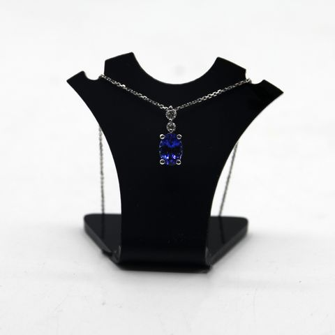 Lot 19 DESIGNER WHITE GOLD PENDANT ON CHAIN, SET WITH AN OVAL TANZANITE & DIAMOND ACCENTS WEIGHT +-1.26ct