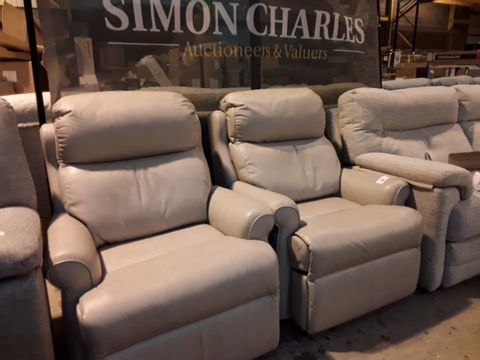 Lot 609 PAIR OF QUALITY BRITISH MANUFACTURED HARDWOOD FRAMED BEIGE LEATHER POWER RECLINING EASY CHAIRS