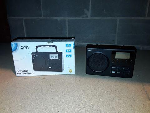 Lot 10093 BOXED ONN PORTABLE AM/FM RADIO